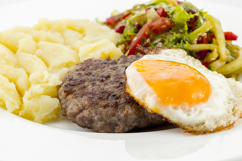 cutlet with fried egg and potatoes Puree