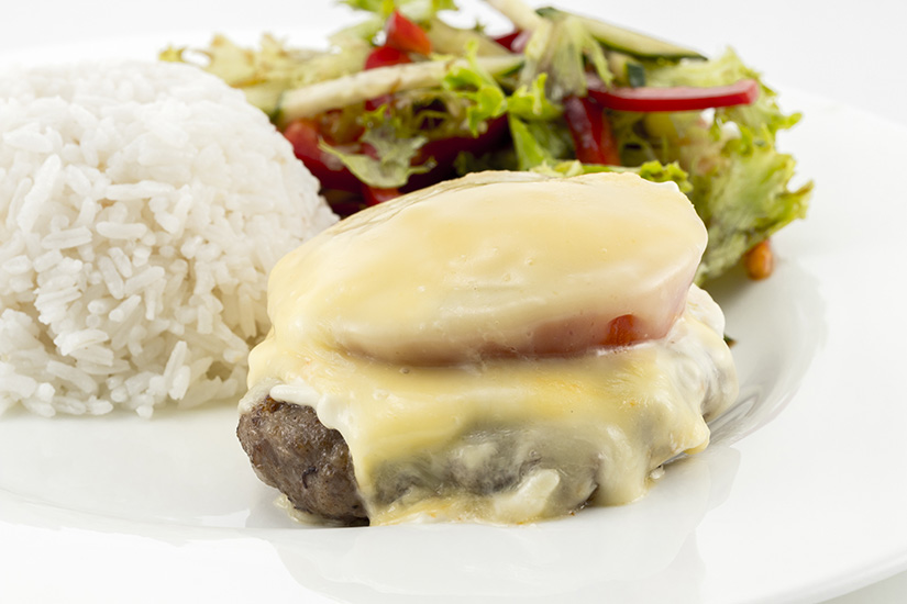 cutlet with melted cheese, rice and salad